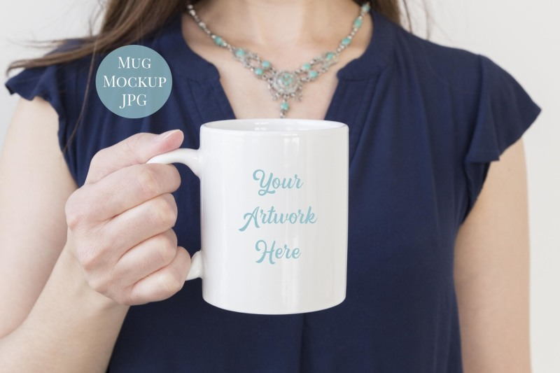 Free Woman holding Mug (PSD Mockups)