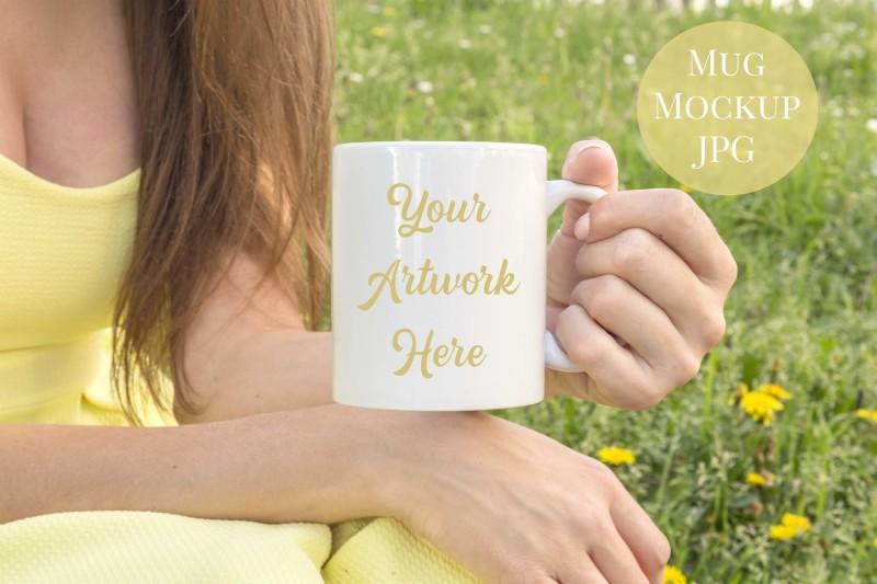 Free Woman holding mug - yellow dress (PSD Mockups)