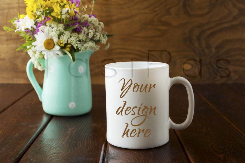 Free White coffee mug rustic mockup with wildflowers in mint green vase (PSD Mockups)