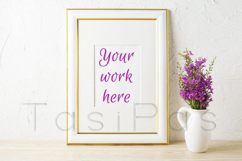 Free Gold decorated frame mockup and purple wildflowers in pitcher (PSD Mockups)