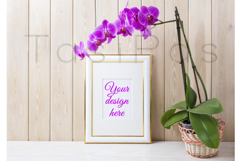 gold-decorated-frame-mockup-with-purple-orchid-in-wicker-basket