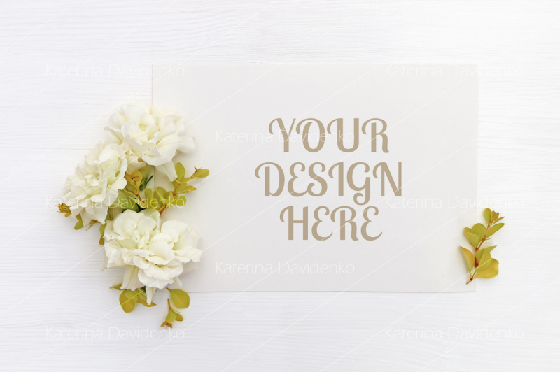 Free Mockup with a blank A5 paper sheet, white flowers (PSD Mockups)