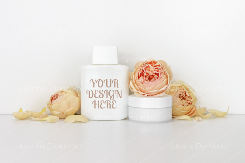 Free Cosmetics mockup with roses, bottle contain (PSD Mockups)
