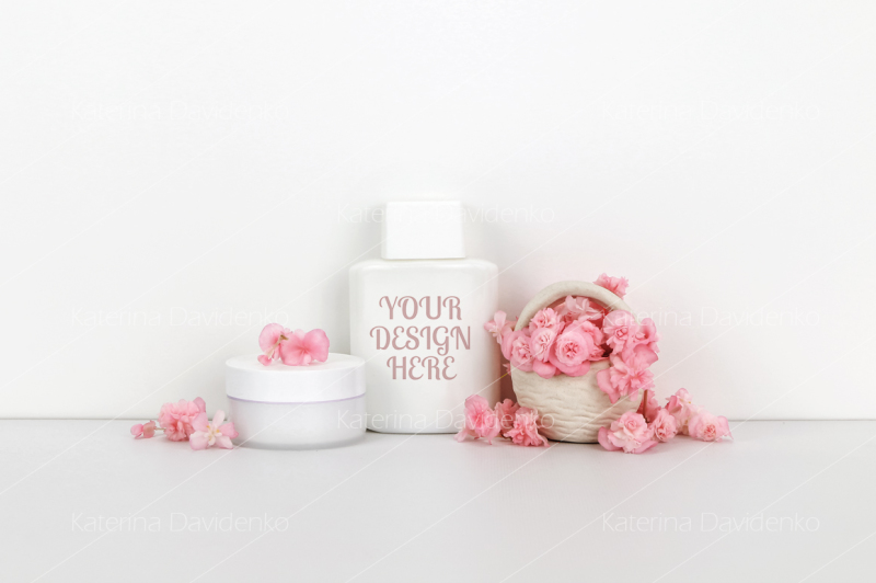 Free Cosmetics mockup with pink flowers, bottle contain (PSD Mockups)