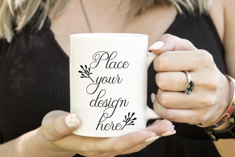 Free Girl holding coffee mug white cup mockup feminine with woman hands (PSD Mockups)