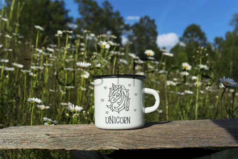 Free White campfire enamel mug mockup with daisy field. (PSD Mockups)