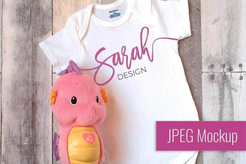 Free JPEG Flatlay Mockup | Gerber White Unisex Body Suit for Baby (PSD Mockups)