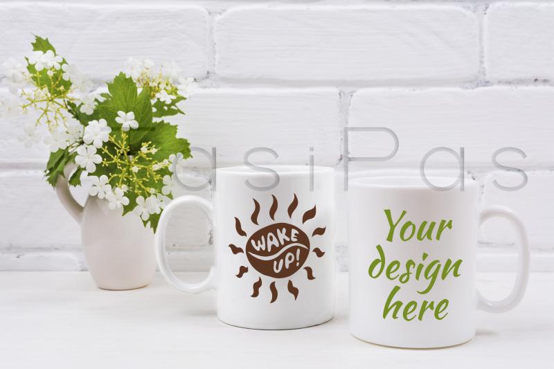 Free Two white coffee mug mockup with viburnum flowers (PSD Mockups)