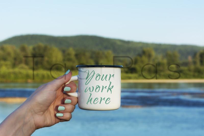 Free Woman holding enamel mug with river view. (PSD Mockups)