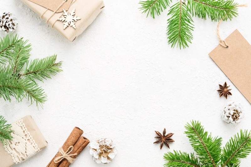 christmas-frame-of-gifts-natural-fir-and-new-year-decoration-on-white