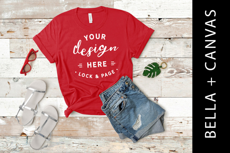 red-bella-canvas-3001-t-shirt-mockup-wood-backdrop-fashion-flat-lay