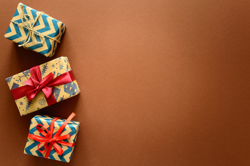 top-view-on-christmas-gifts-wrapped-in-gift-paper