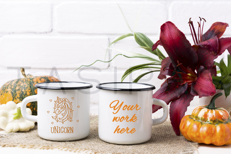 two-white-campfire-enamel-mug-mockup-with-pumpkin-and-lily