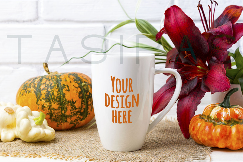 Free White coffee cappuccino mug mockup with pumpkin and red lily. (PSD Mockups)