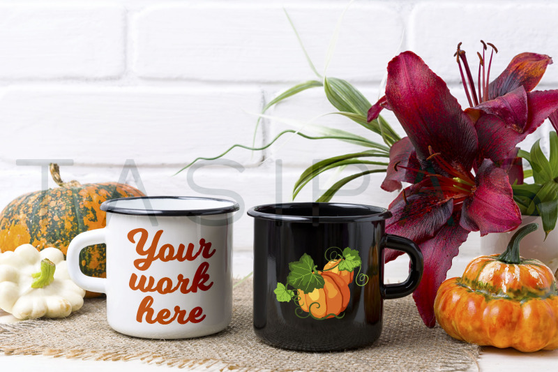 Free White and black campfire mug mockup with pumpkin and red lily. (PSD Mockups)
