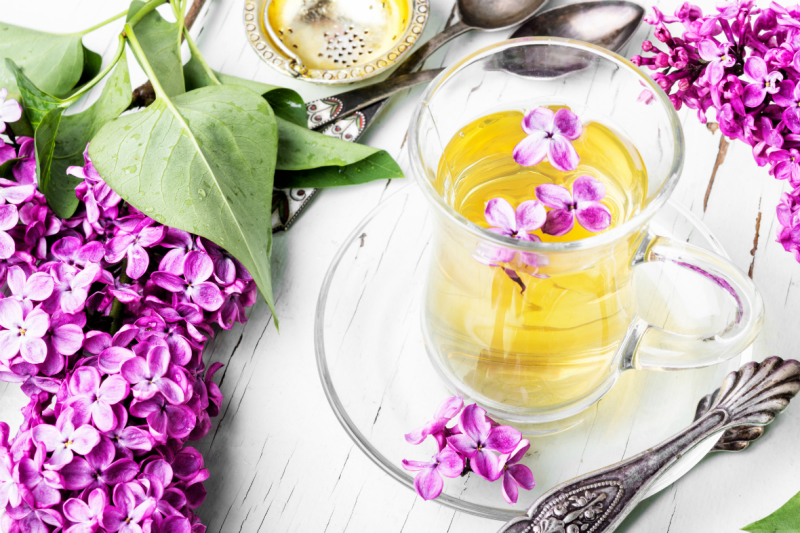 cup-of-tea-and-lilac-flowers