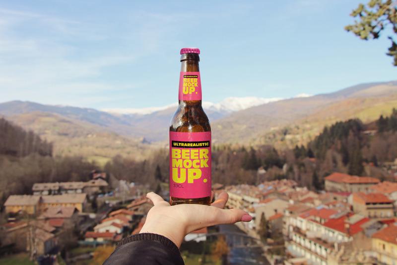 Free Hand Beer Mockup (PSD Mockups)