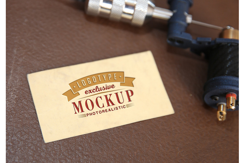 Free Photorealistic mock-ups with tattoo machine on background (PSD Mockups)