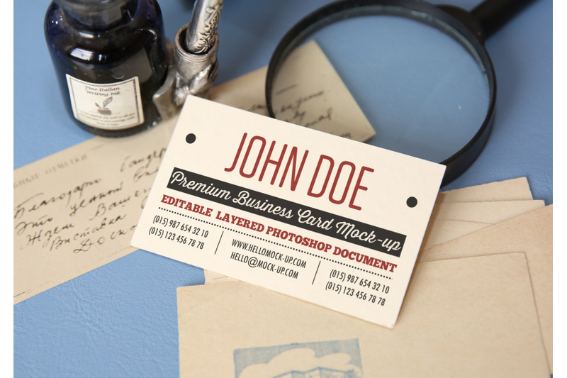 Free Business card template on letters with envelopes on background (PSD Mockups)
