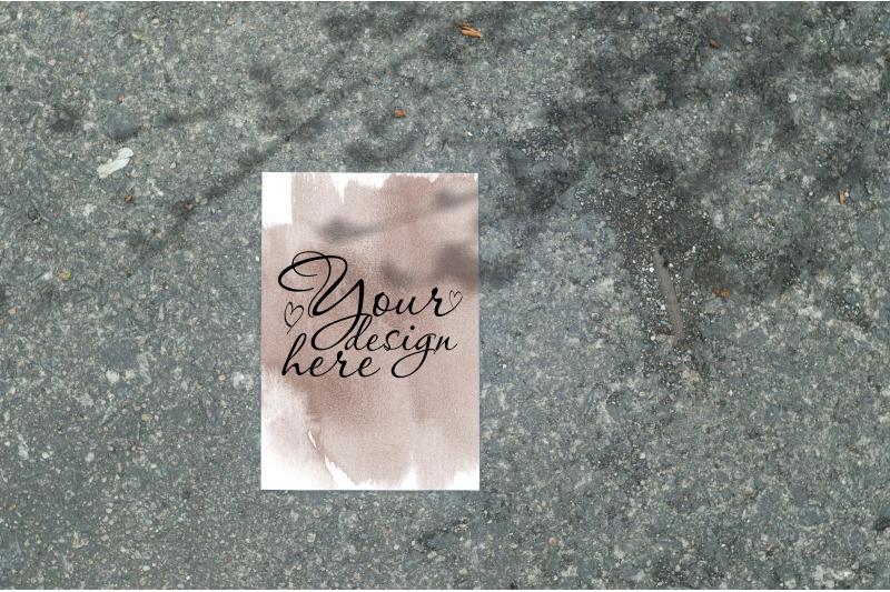 Free Card 3,5x5 mockup on gray asphalt with shadow (PSD Mockups)