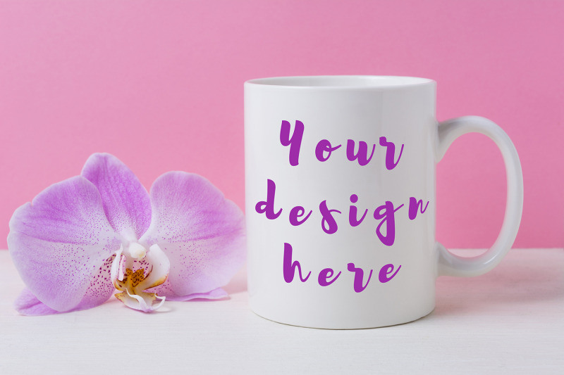Free White coffee mug mockup with purple orchid (PSD Mockups)