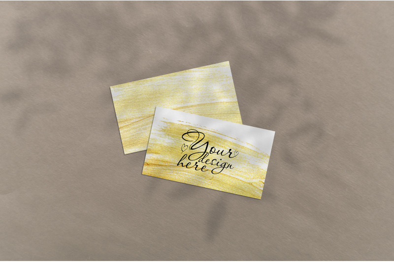 Free Business card Mockup. Natural overlay lighting shadows the leaves (PSD Mockups)