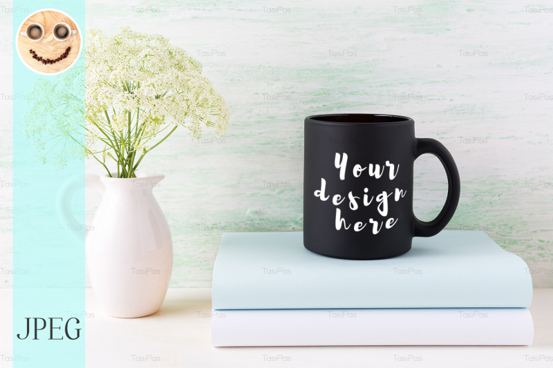 Free Black coffee mug mockup with books and tender white flowers. (PSD Mockups)