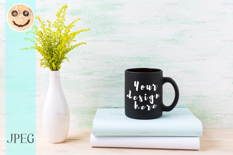 Free Black coffee mug mockup with ornamental green grass and books. (PSD Mockups)