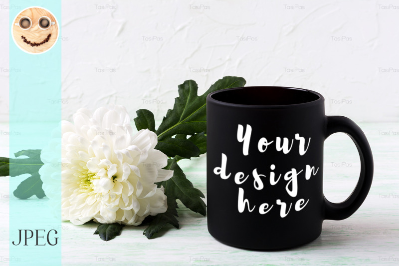 Free Black coffee mug mockup with white chrysanthemum (PSD Mockups)
