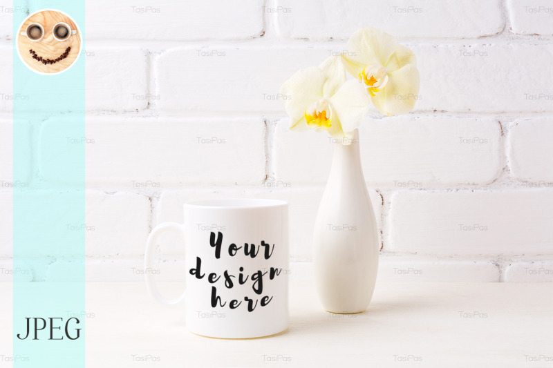 Free White coffee mug mockup with soft yellow orchid in vase (PSD Mockups)