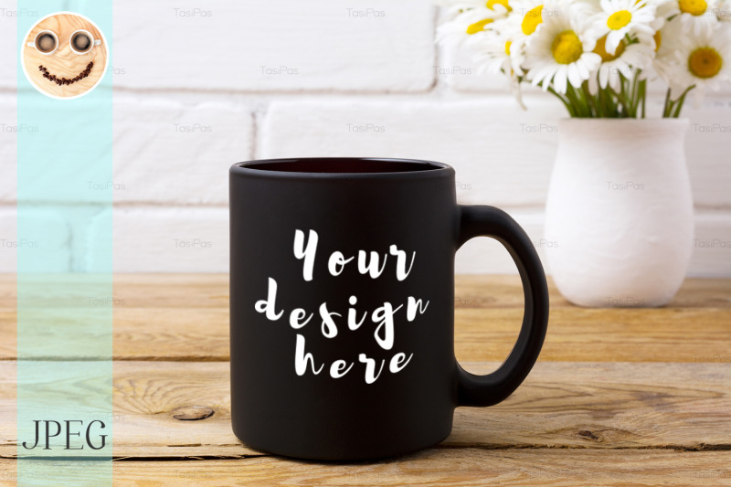 Free Black coffee mug mockup with chamomile bouquet in rustic vase. (PSD Mockups)