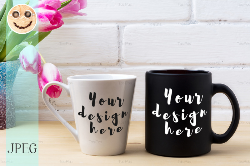 Free Black coffee cup and white latte mug mockup with magenta tulip (PSD Mockups)