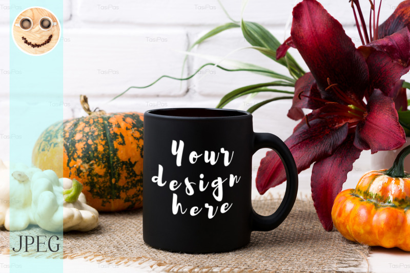 Free Black coffee mug mockup with pumpkin and red lily (PSD Mockups)