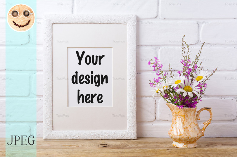 Free White frame mockup with chamomile and purple flowers in golden pitcher (PSD Mockups)