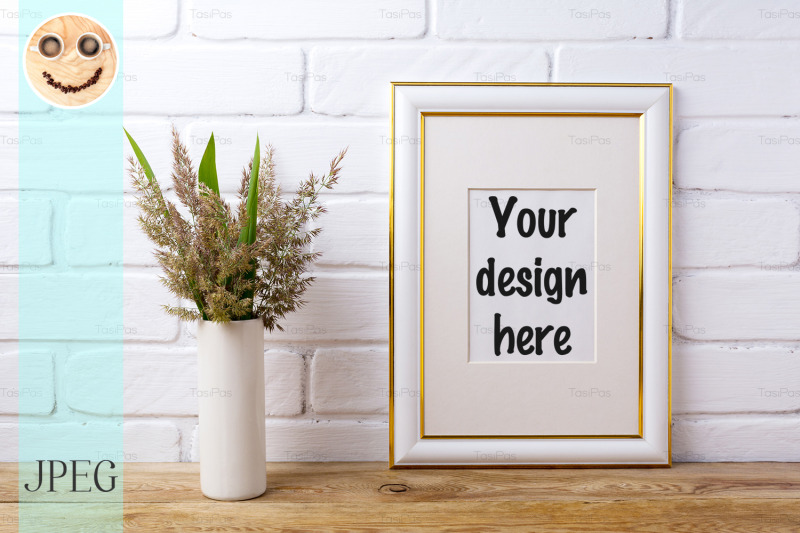 Free Gold decorated frame mockup with grass and green leaves in cylinder v (PSD Mockups)