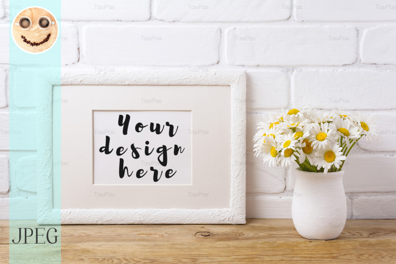 white-landscape-frame-mockup-with-chamomile-bouquet-in-rustic-vase