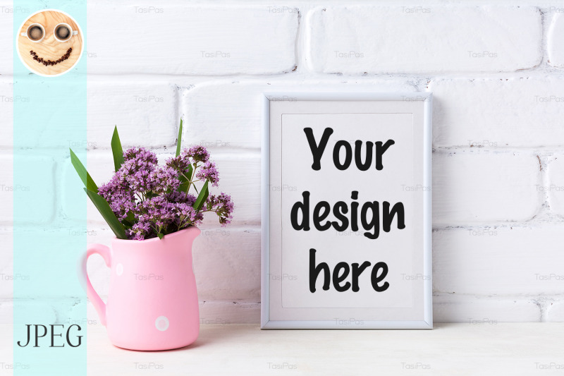 Free White frame mockup with purple flowers in pink rustic pitcher (PSD Mockups)