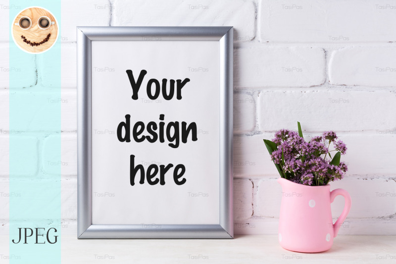 Free Silver frame mockup with purple flowers in pink rustic pitcher (PSD Mockups)