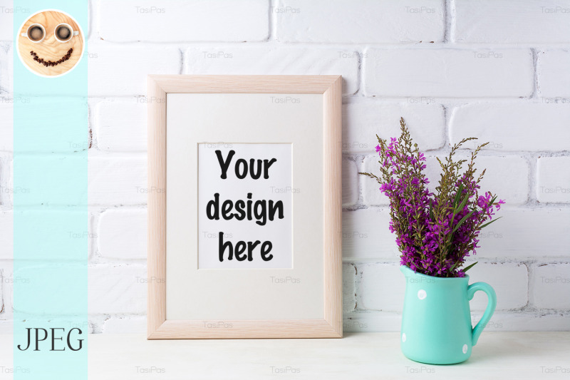 Free Wooden frame mockup with maroon purple flowers in mint pitcher (PSD Mockups)
