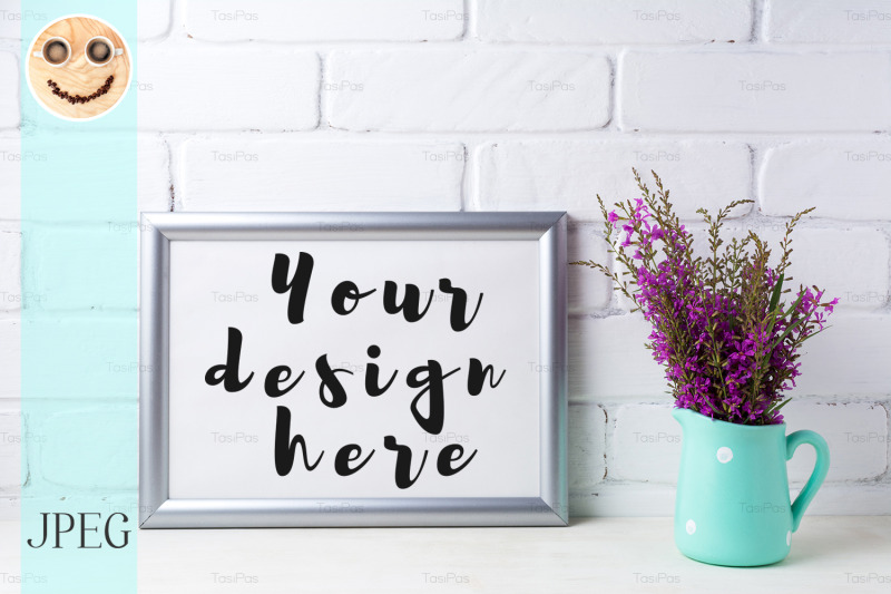 Free Silver landscape frame mockup with maroon purple flowers in mint pitch (PSD Mockups)