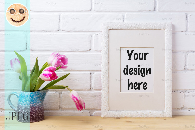 Free White frame mockup with pink tulip in blue pitcher (PSD Mockups)