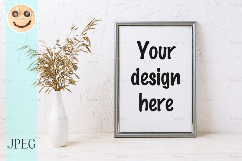 Free Silver frame mockup with decorative dried grass (PSD Mockups)
