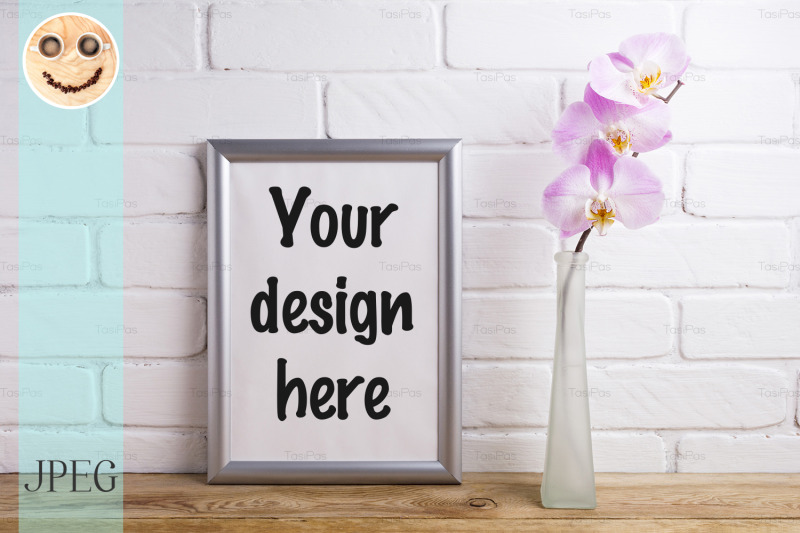 Free Silver frame mockup with tender pink orchid (PSD Mockups)