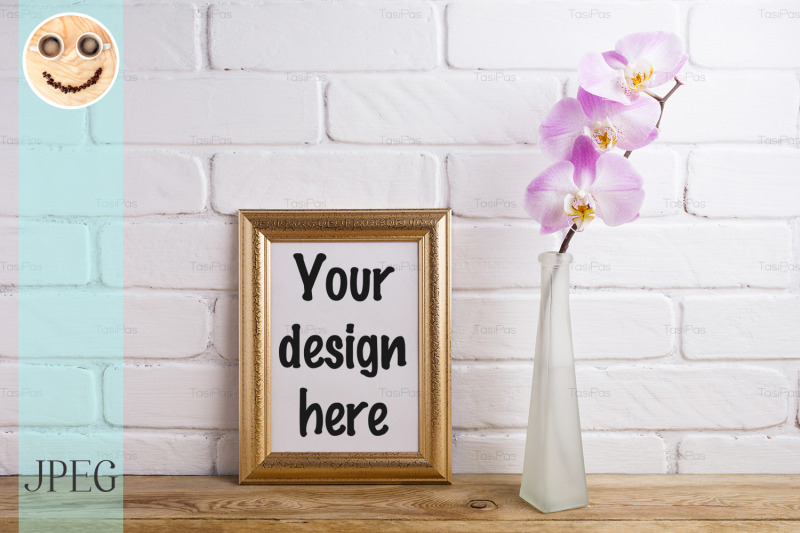Free Gold decorated frame mockup with tender pink orchid (PSD Mockups)