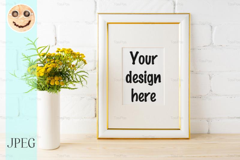 gold-decorated-frame-mockup-yellow-flowers-near-brick-walls