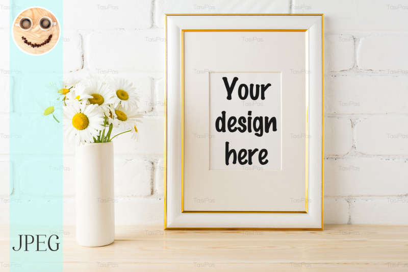 Free Gold decorated frame mockup with daisy near painted brick wall (PSD Mockups)
