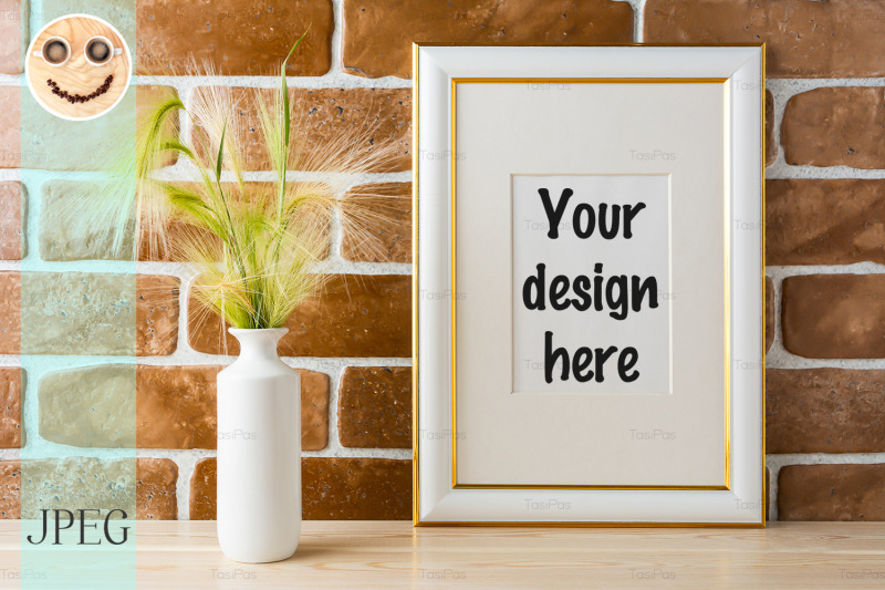 Free Gold decorated frame mockup with ornamental grass exposed brick wall (PSD Mockups)