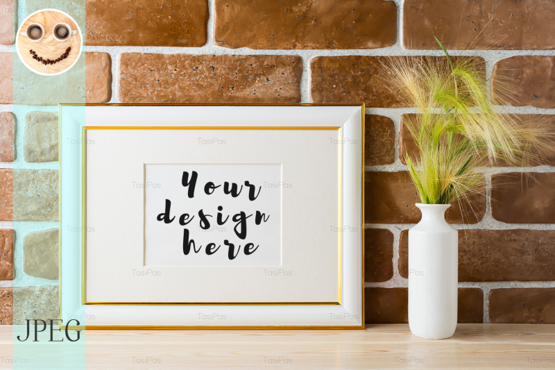 Free Gold decorated landscape frame mockup with ornamental grass in styled (PSD Mockups)