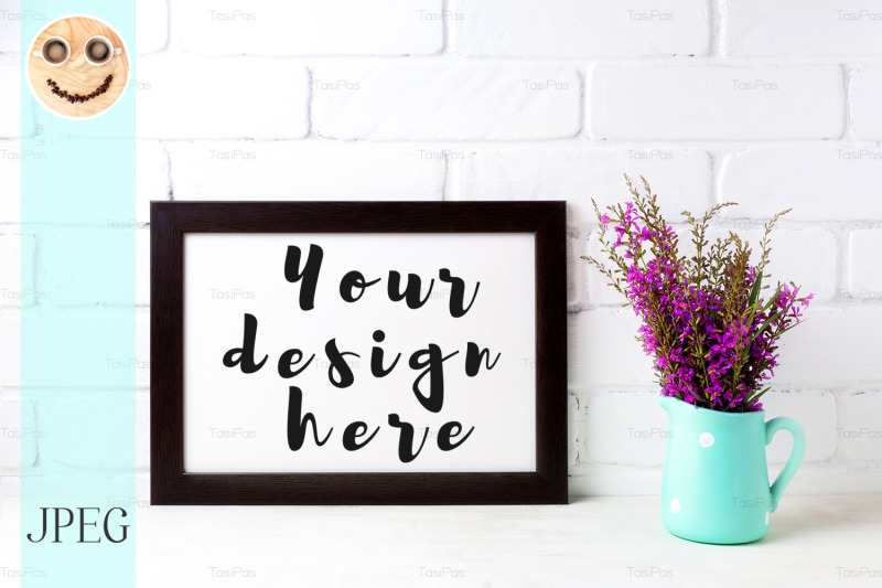 Free Wooden frame mockup with magenta flowers in mint pitcher (PSD Mockups)
