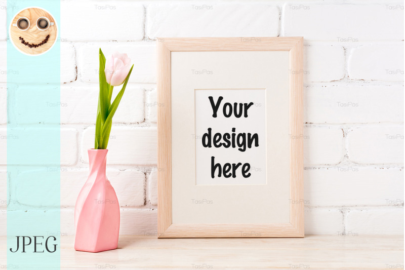 Free Wooden frame mockup with pink tulip in swirled vase (PSD Mockups)